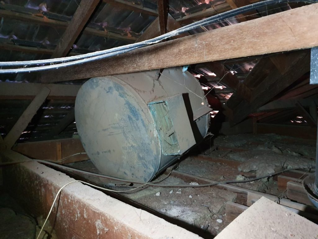 Interior view of damaged roof caused by open cavity